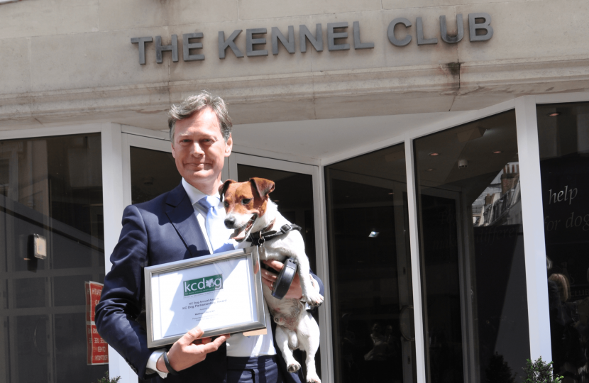 Matthew and Max receiving a reward from the Kennel Club