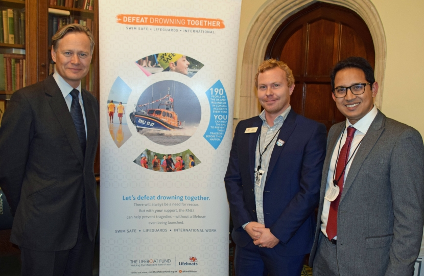 Matthew Offord MP with volunteers and staff of the Lifeboat Fund in Parliament